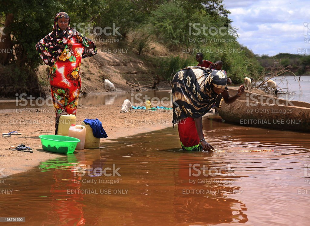 Somali women washing in the Tana River, Kenya stock photo