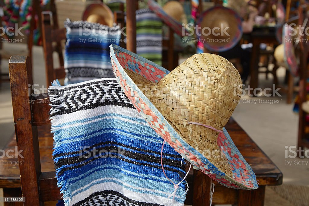 Sombrero And Mexican Blanket Hang Over Chair Back royalty-free stock photo