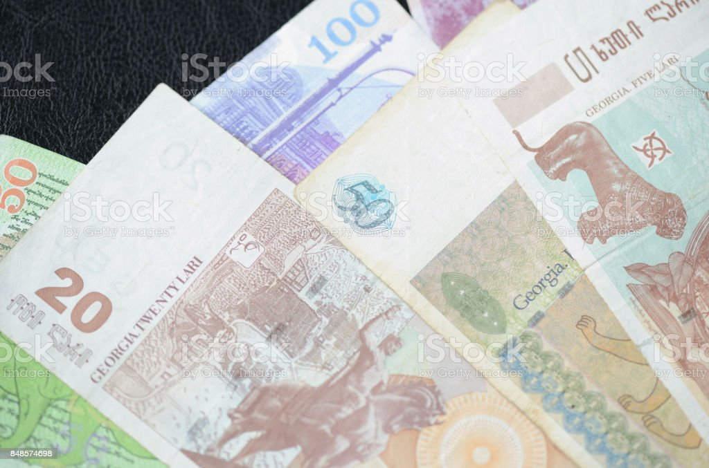 Some banknotes of Georgian lari on a dark background stock photo