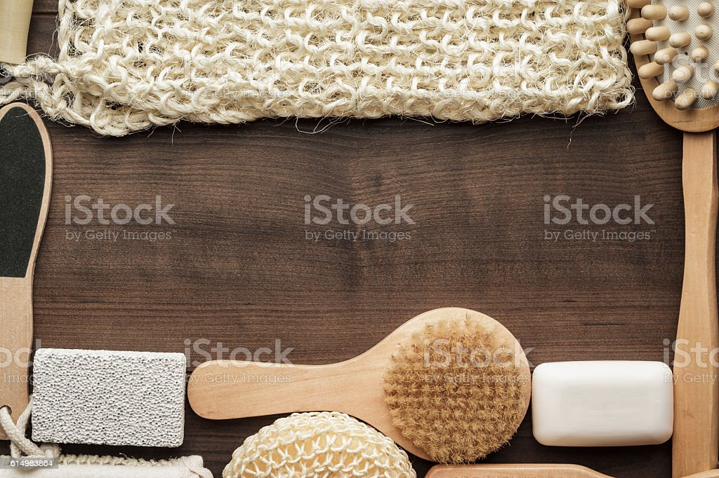 some bath accessories on brown wooden background stock photo