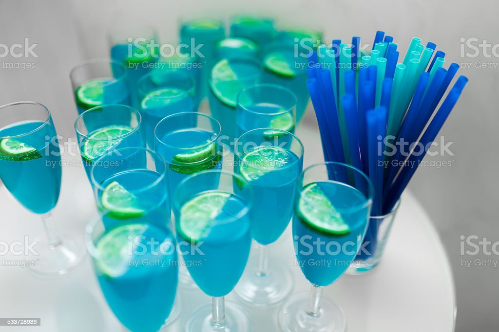 Some blue cocktails with lime on table stock photo