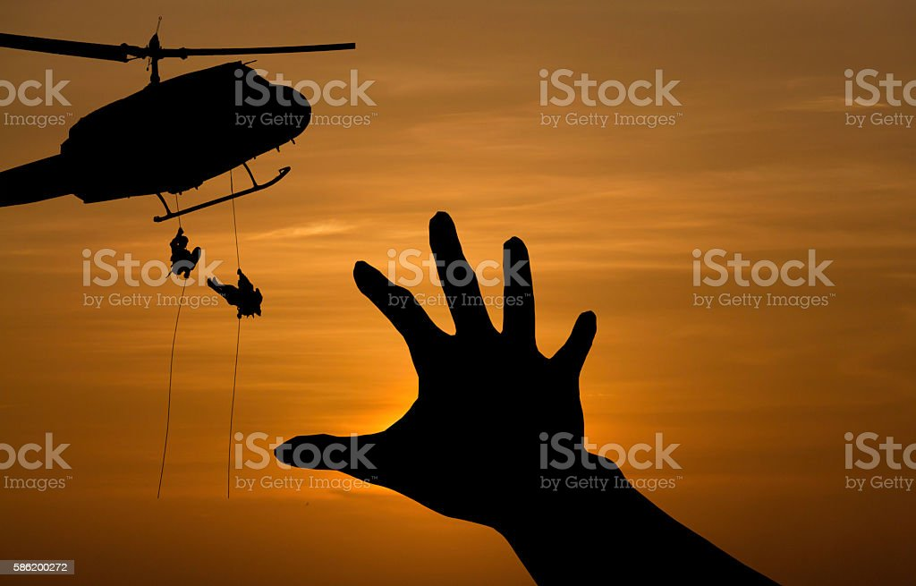some body need  for help from a military helicopter rescue stock photo