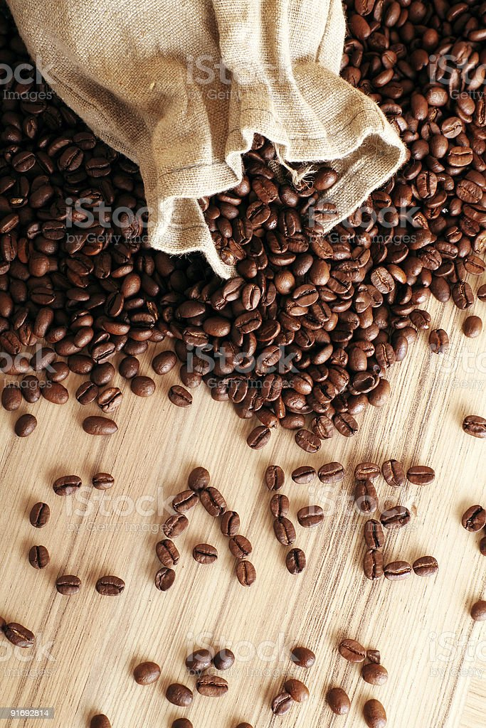 some coffee beans and a jute sack royalty-free stock photo