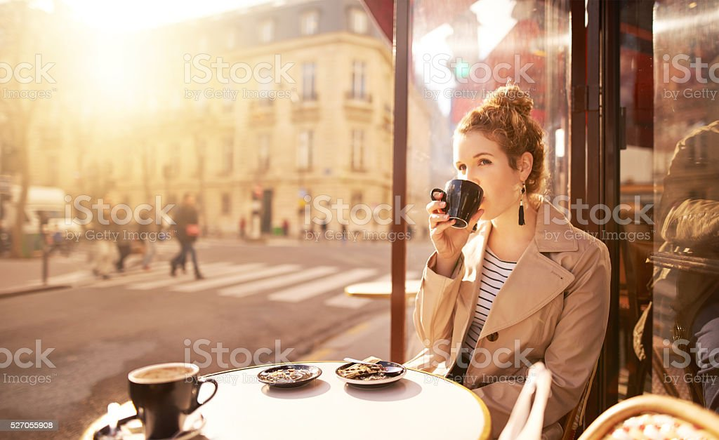 Some coffee to fuel her contemplation stock photo