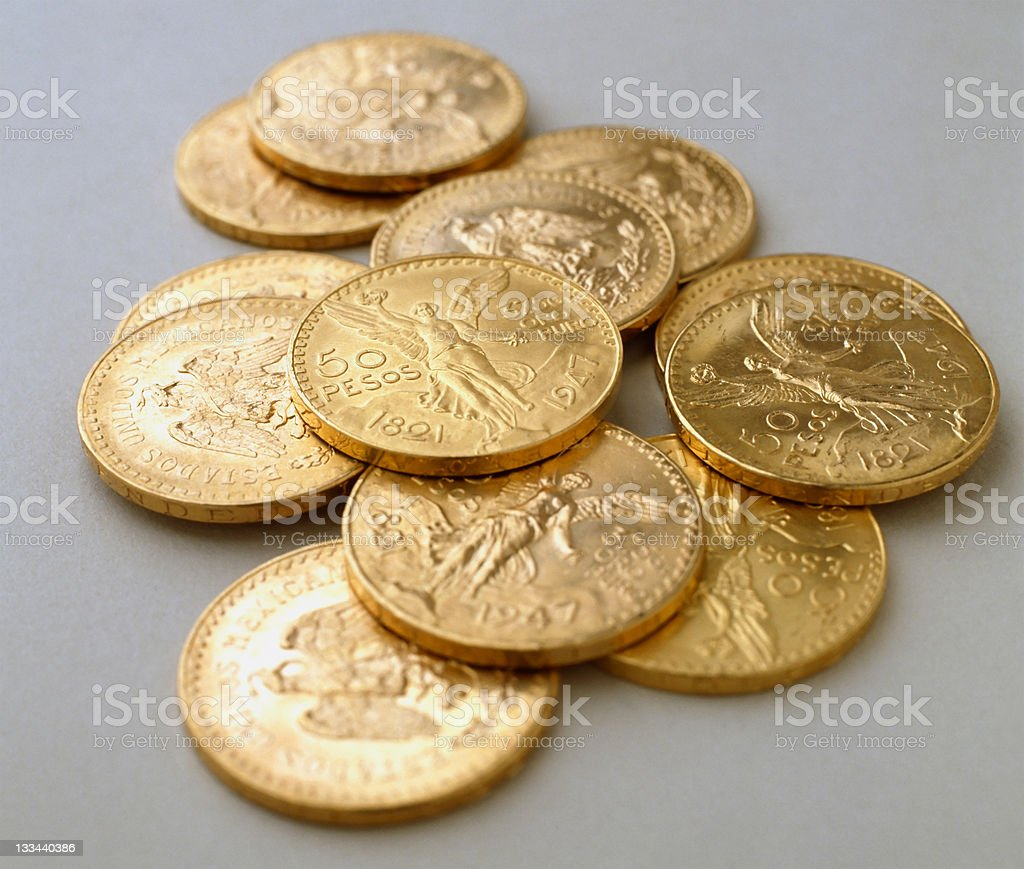Some coins of 50 pesos gold stock photo