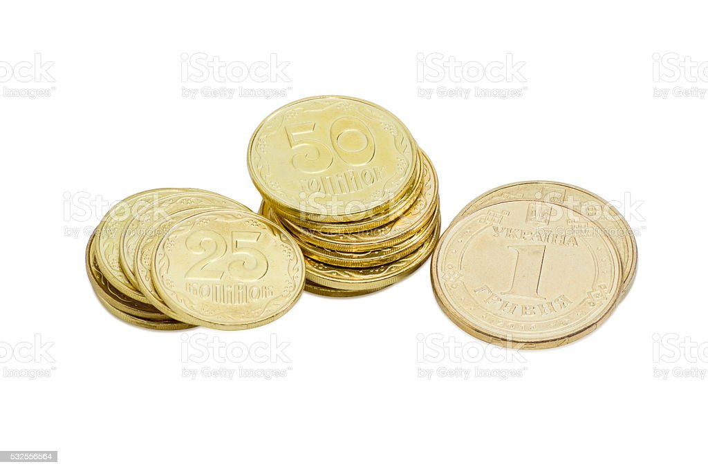 Some coins of the Ukrainian hryvnia on a light background stock photo