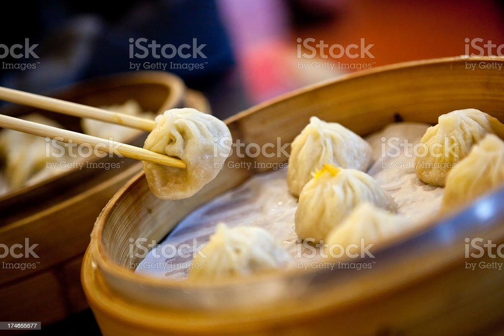 Some dumplings in a bamboo steamer stock photo