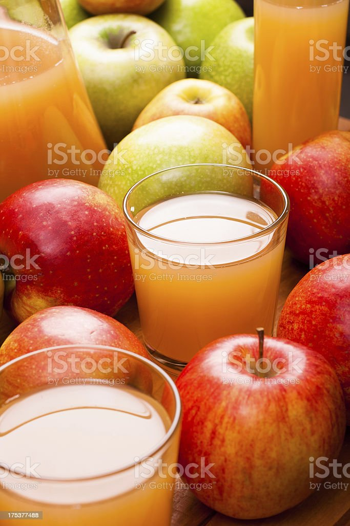 Some glasses of apple juice royalty-free stock photo