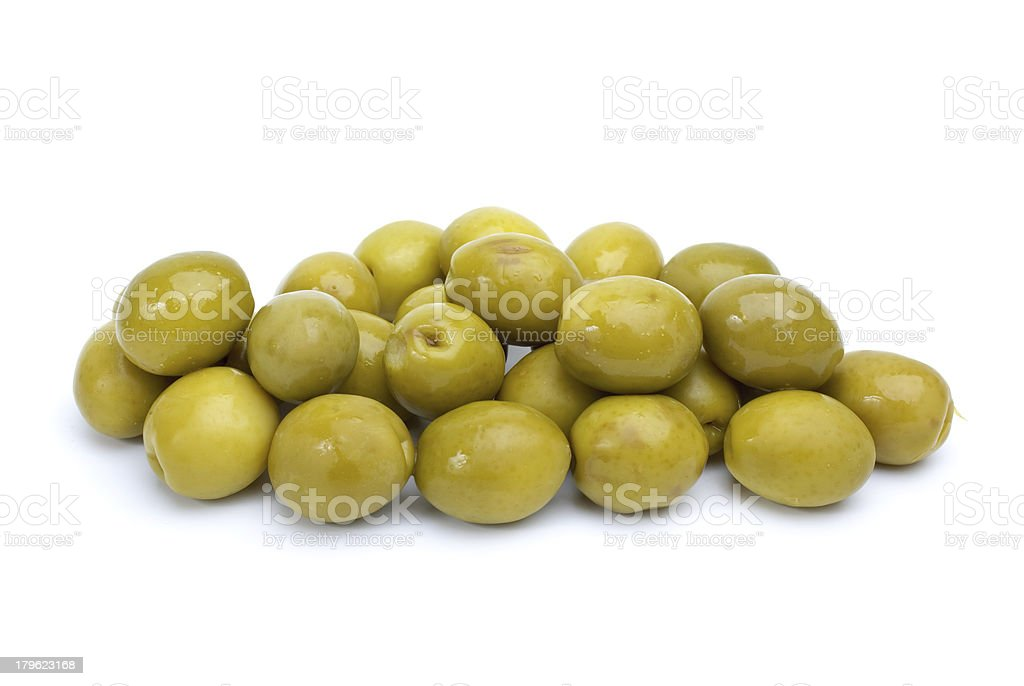 Some green olives with pits stock photo