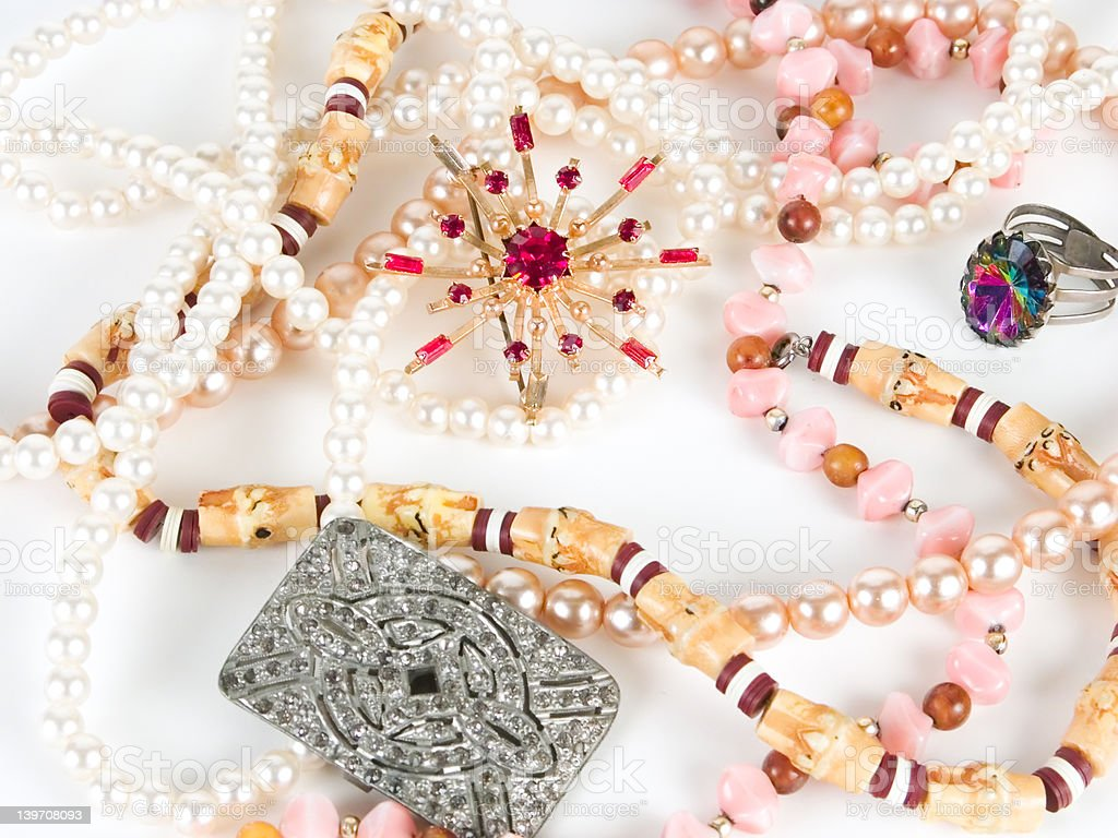 Some jewellery against white background stock photo