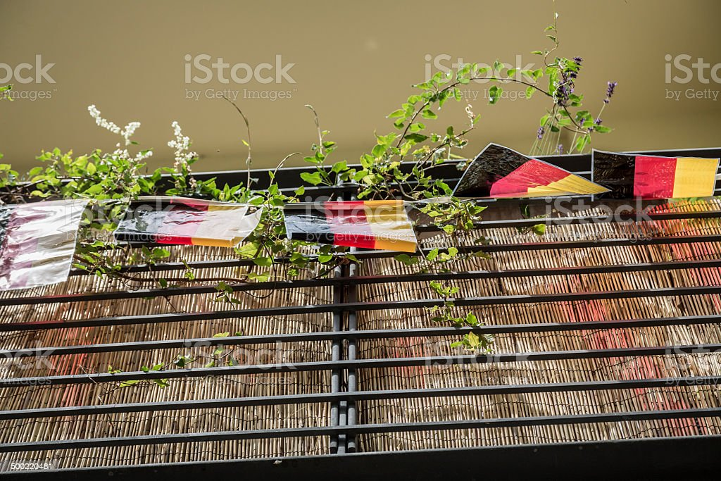 some little german flags hanging on a balcony stock photo