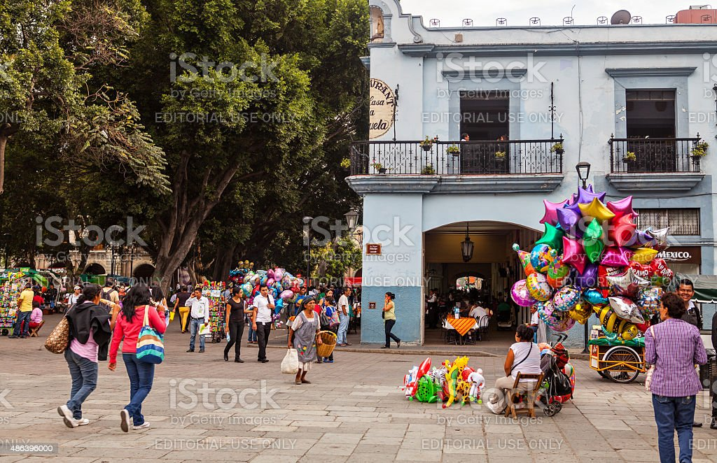 Some locals in the Zocalo, Oaxaca de Juarez, Mexico stock photo