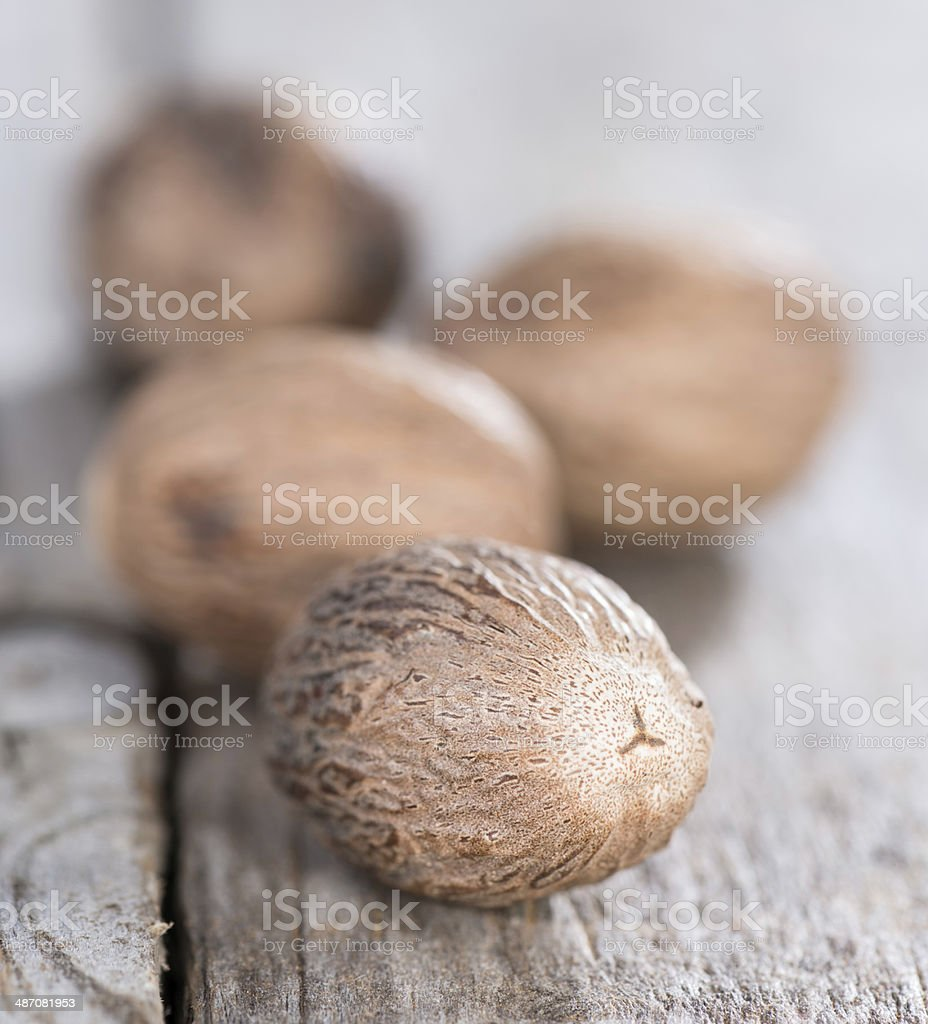Some Nutmegs (close-up shot) stock photo