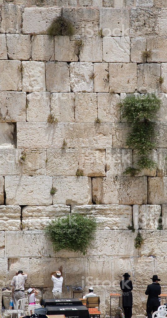 Some people on the Jerusalem Wailing Wall royalty-free stock photo