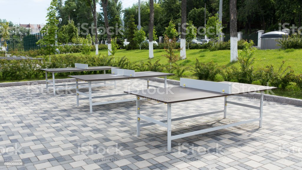 Some ping pong tables in a public park stock photo