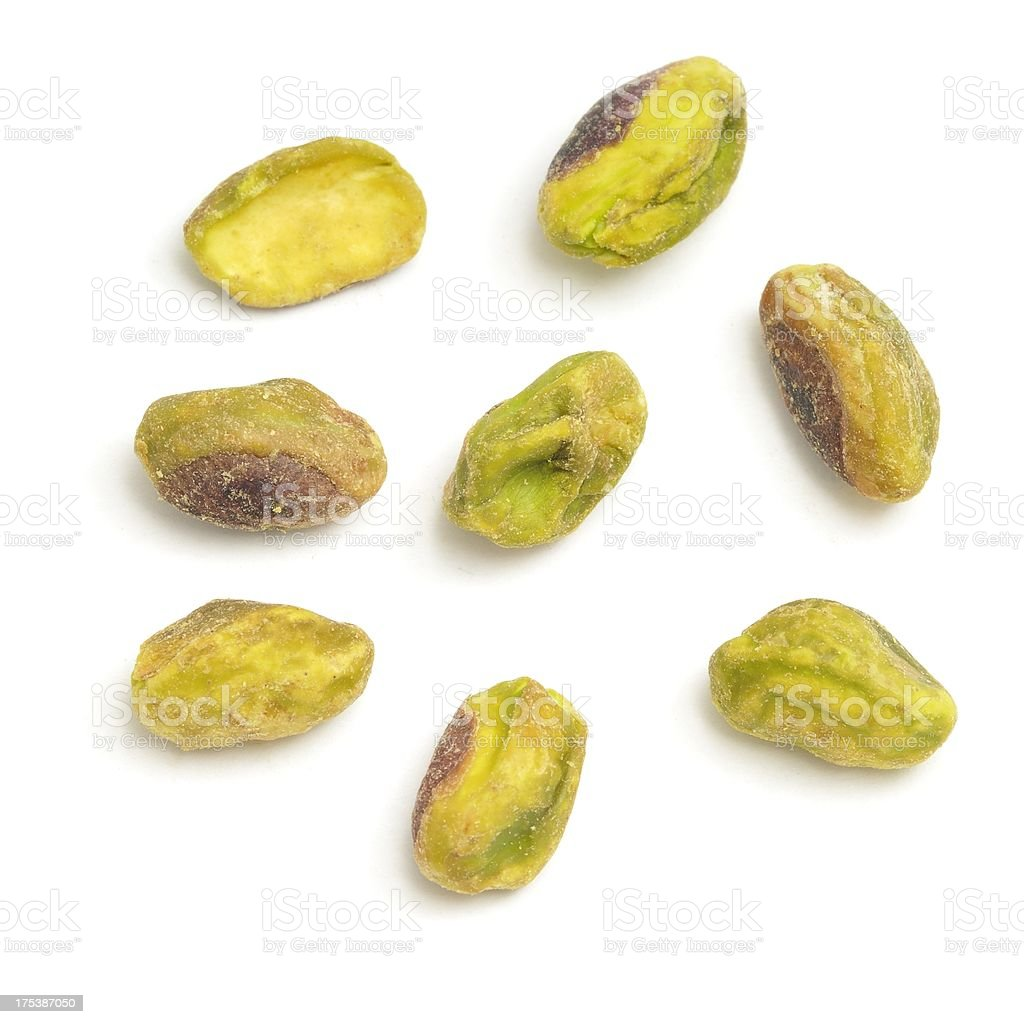 Some shelled Pistachio nuts stock photo
