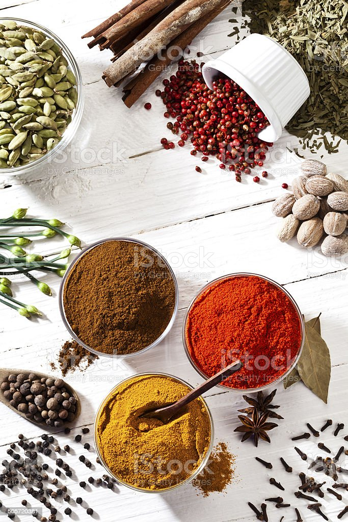 Some spices and herbs shot directly above on white table stock photo