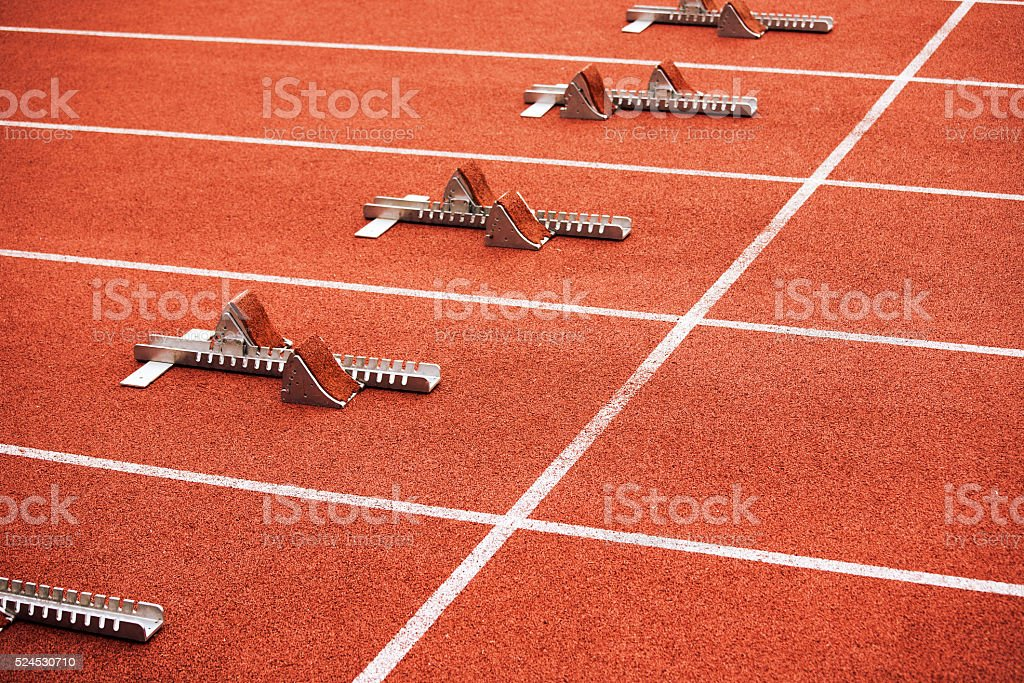Some starting block on running track stock photo