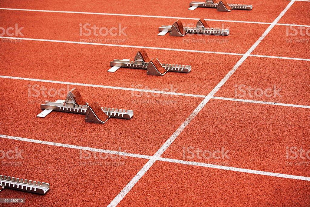 Some starting block on running track stock photo