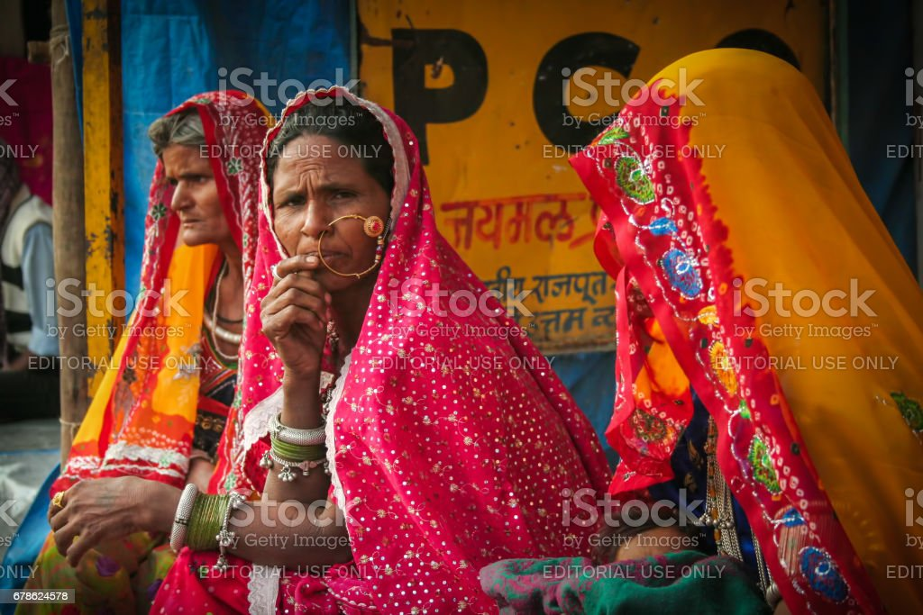 Some unidentified Indian Rajasthani nomadic women in their traditional costume attends Pushkar Camel Fair stock photo