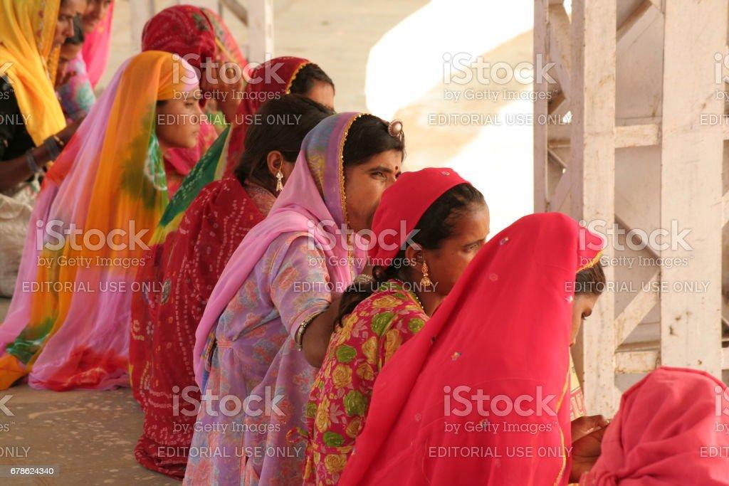 Some unidentified Indian Rajasthani women near holy Pushkar Sarovar (lake)  in the town of pushkar stock photo