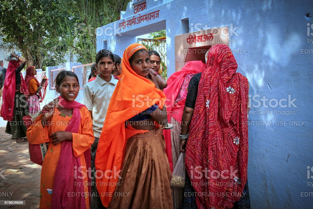Some unidentified Indian Rajasthani women near holy Pushkar Sarovar (lake)  in the town of pushkar in Ajmer District of Rajastha stock photo