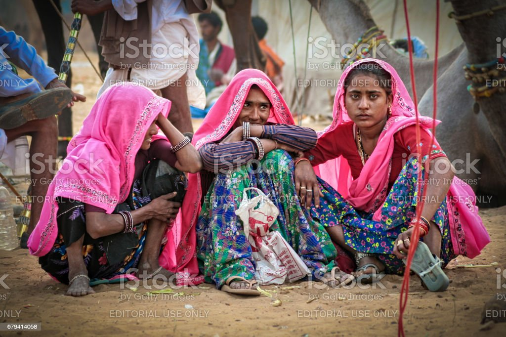 Some unidentified Indian Rajasthani women with a group of people at Pushkar Camel Fair stock photo
