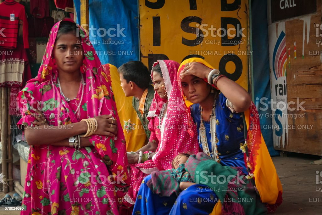 Some unidentified Indian Rajasthani young women in their traditional costume attends Pushkar Camel Fair stock photo