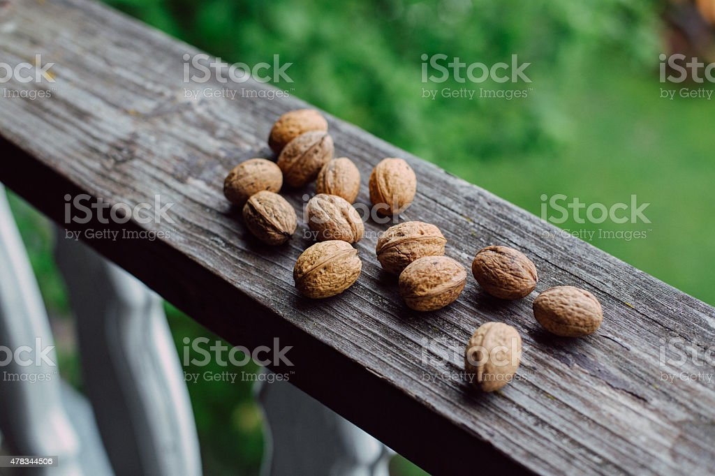 Some walnuts on old rustic wood stock photo