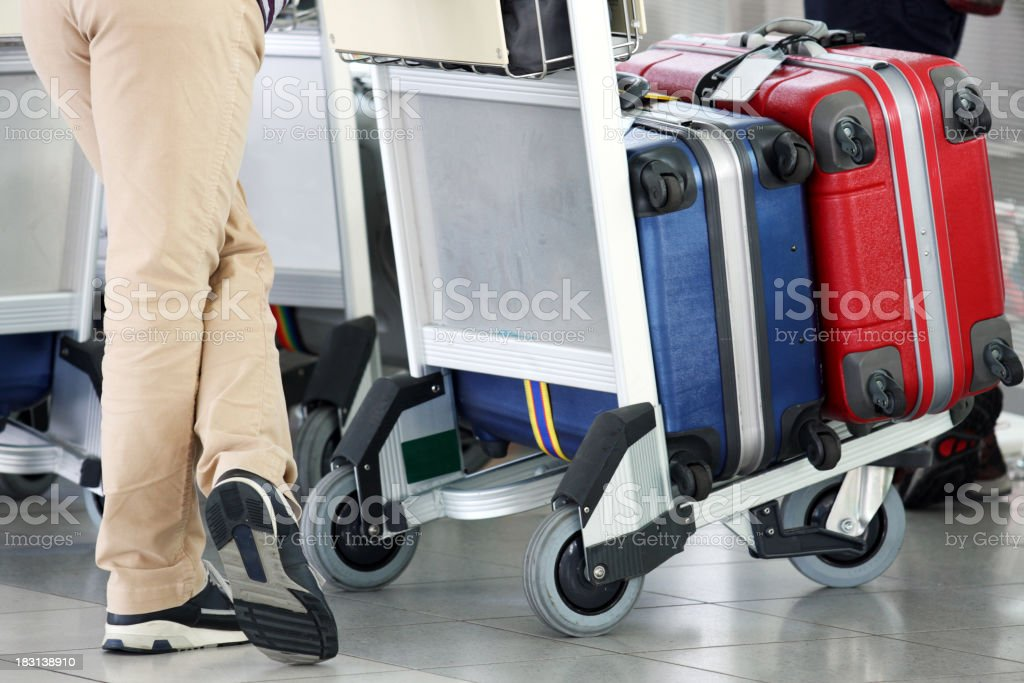 Some women with luggage in cart at the airport stock photo