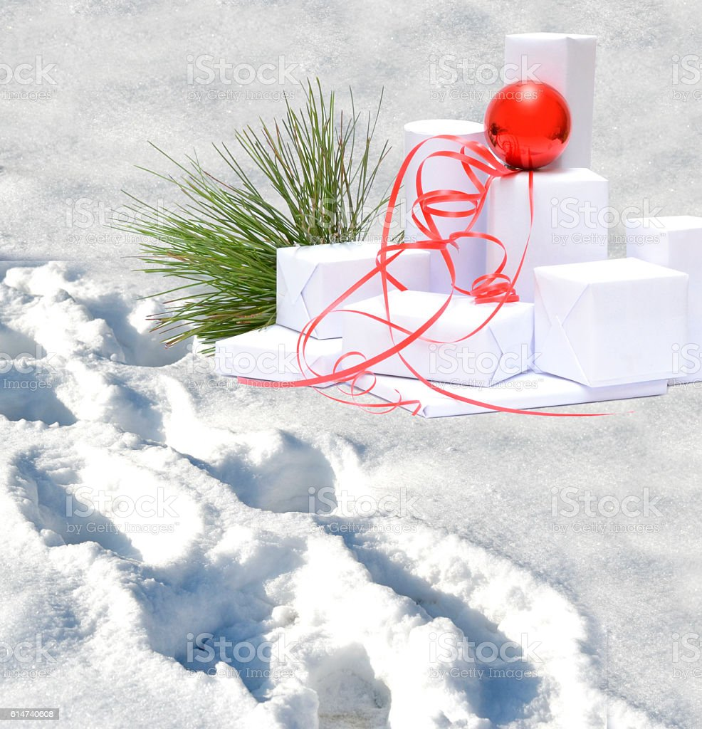 Somebody leaves gifts on the snow stock photo