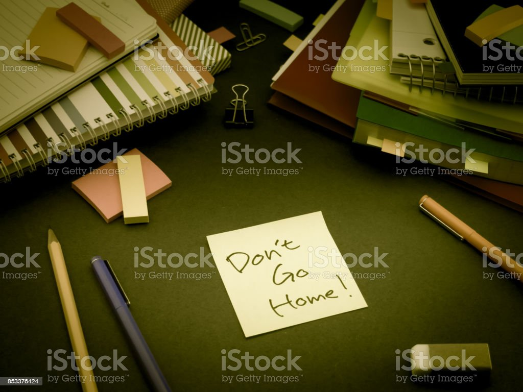 Somebody Left the Message on Your Working Desk; Don't Go Home stock photo