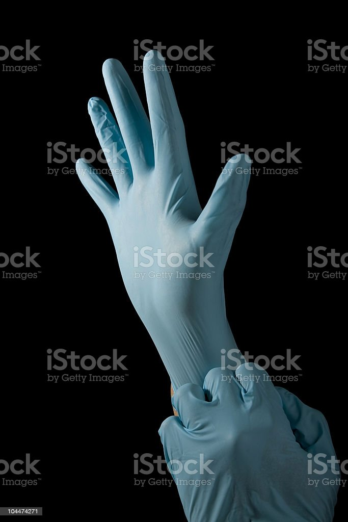 Someone gloving their hands in a black background stock photo