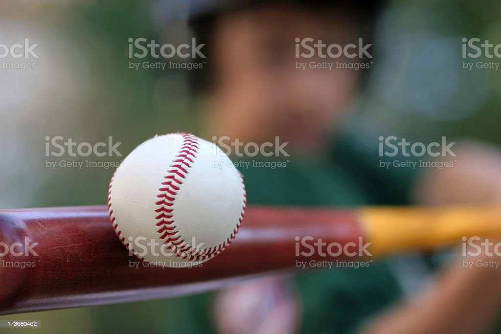 Someone hits the baseball maroon stock photo