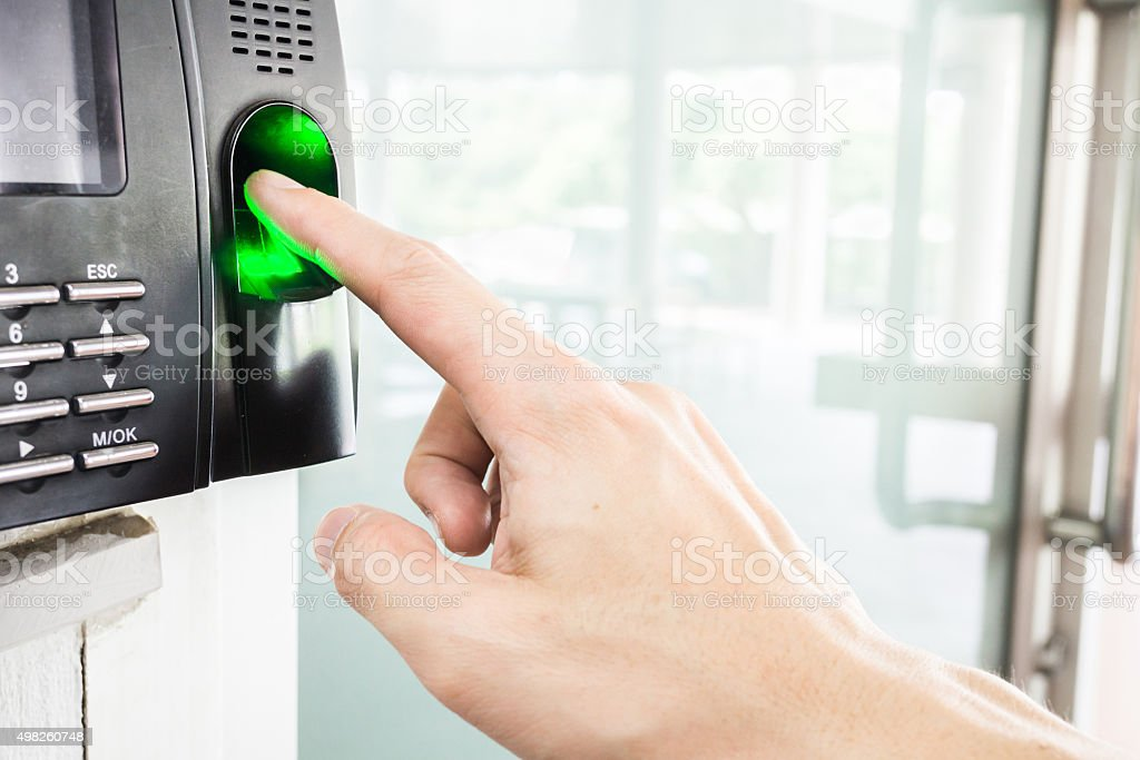 someone is using finger print scanner stock photo