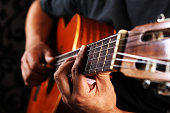 Someone playing chords on a guitar