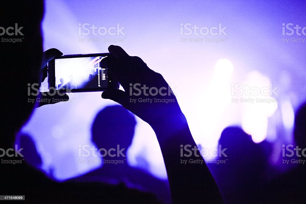 Someone talking pictures during a concert stock photo