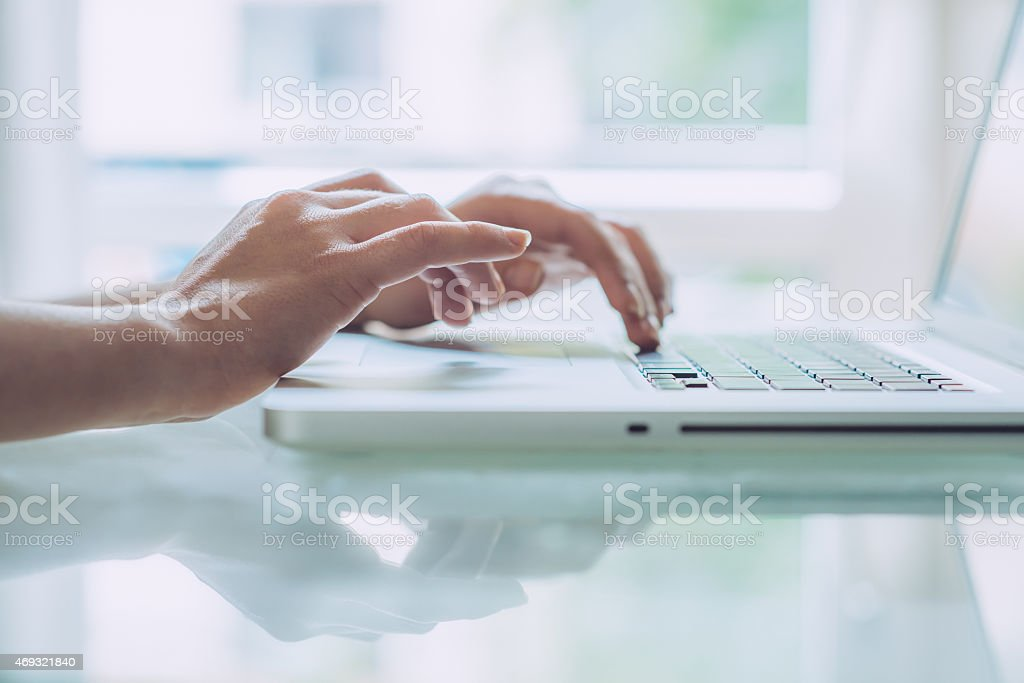 Someone working on their laptop in office stock photo