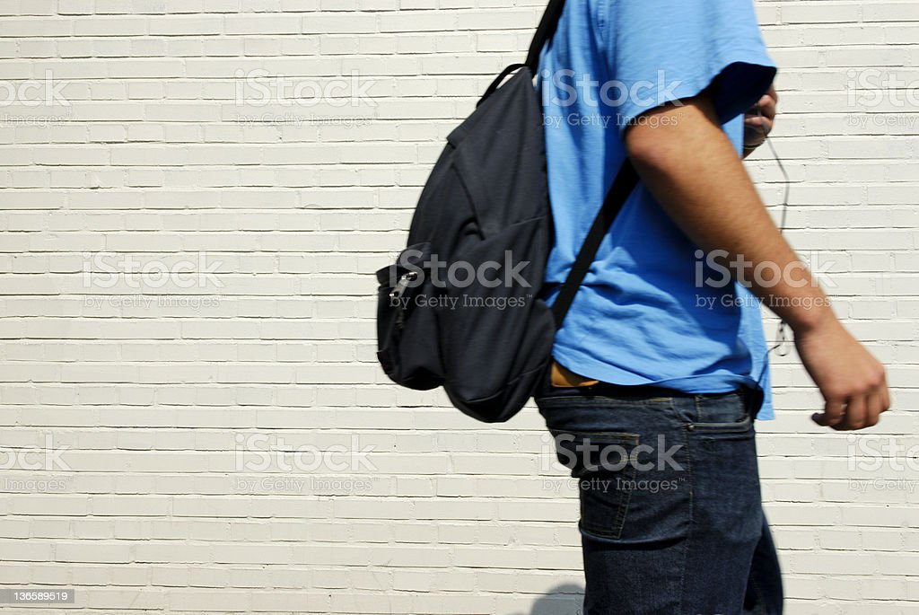 Someone young with a backpack going back to school stock photo