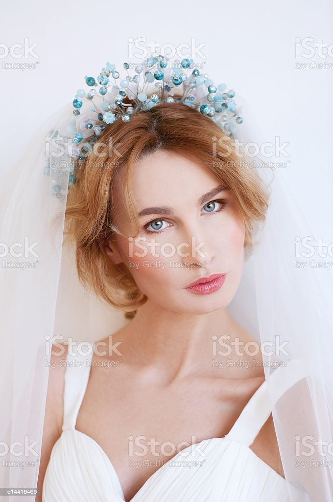 Something blue. Blond bride with beaded headpiece. stock photo