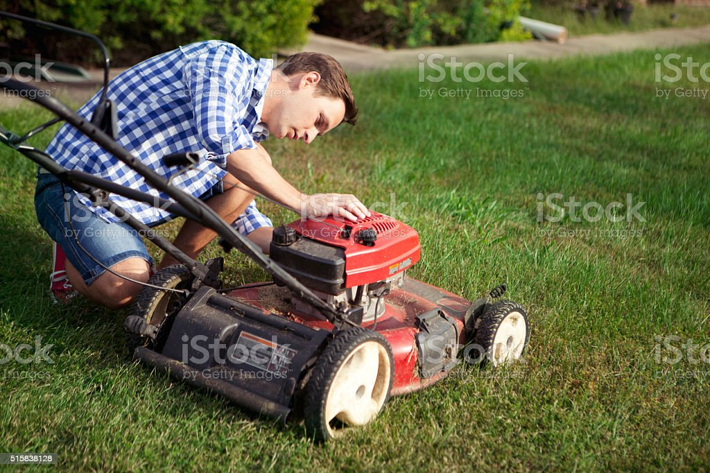 Something wrong with lawnmower stock photo