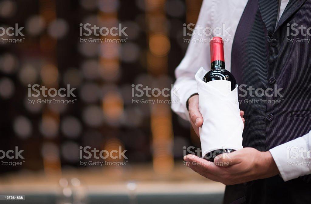Sommelier holding a bottle of wine stock photo