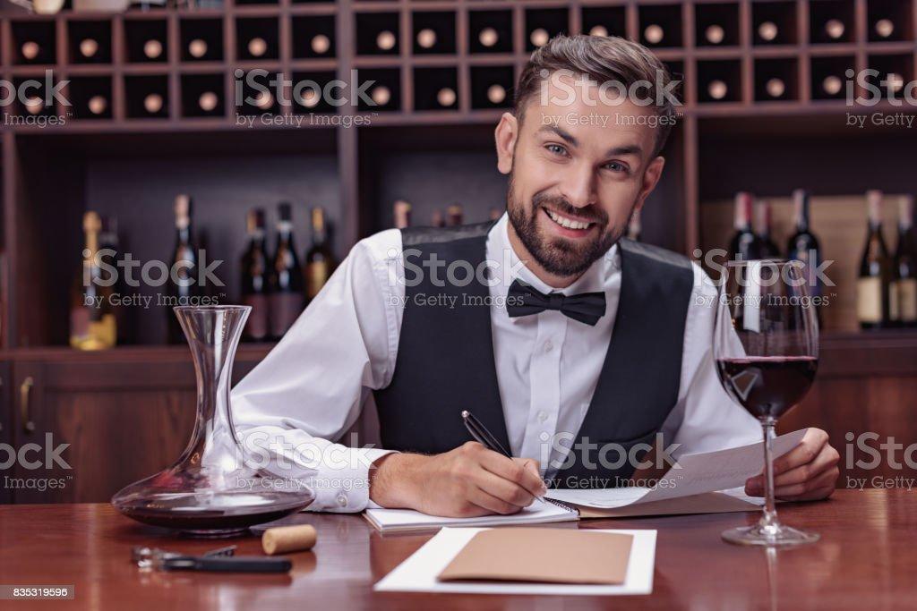 sommelier tasting wine stock photo
