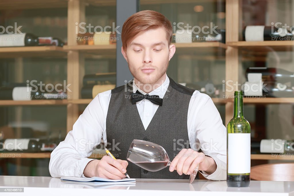 Sommelier testing red wine stock photo
