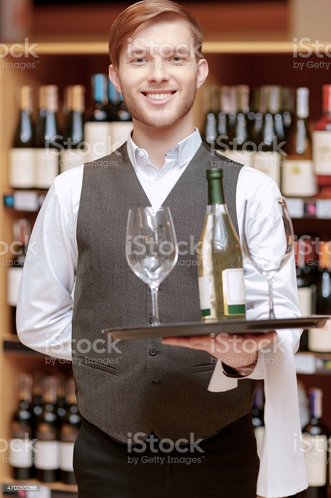 Sommelier with a tray and glasses stock photo