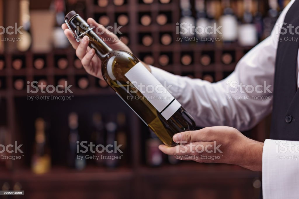 sommelier with bottle of wine stock photo