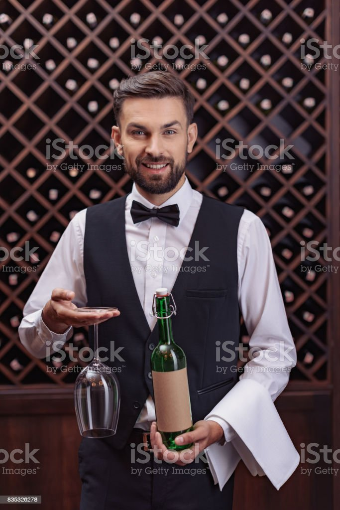 sommelier with wine and glass stock photo