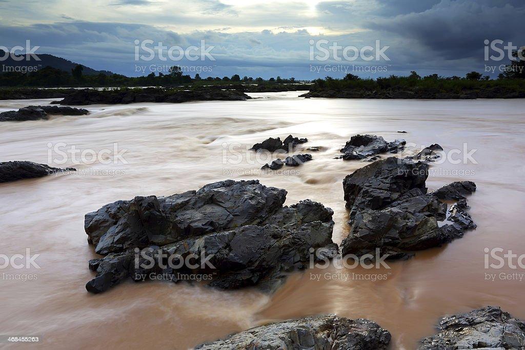 Somphamit Waterfall at sunset, Southern Laos royalty-free stock photo