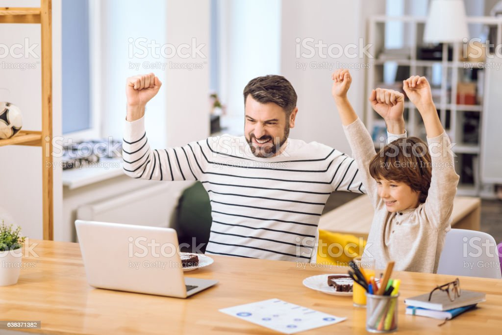 Son and father expressing triumph stock photo