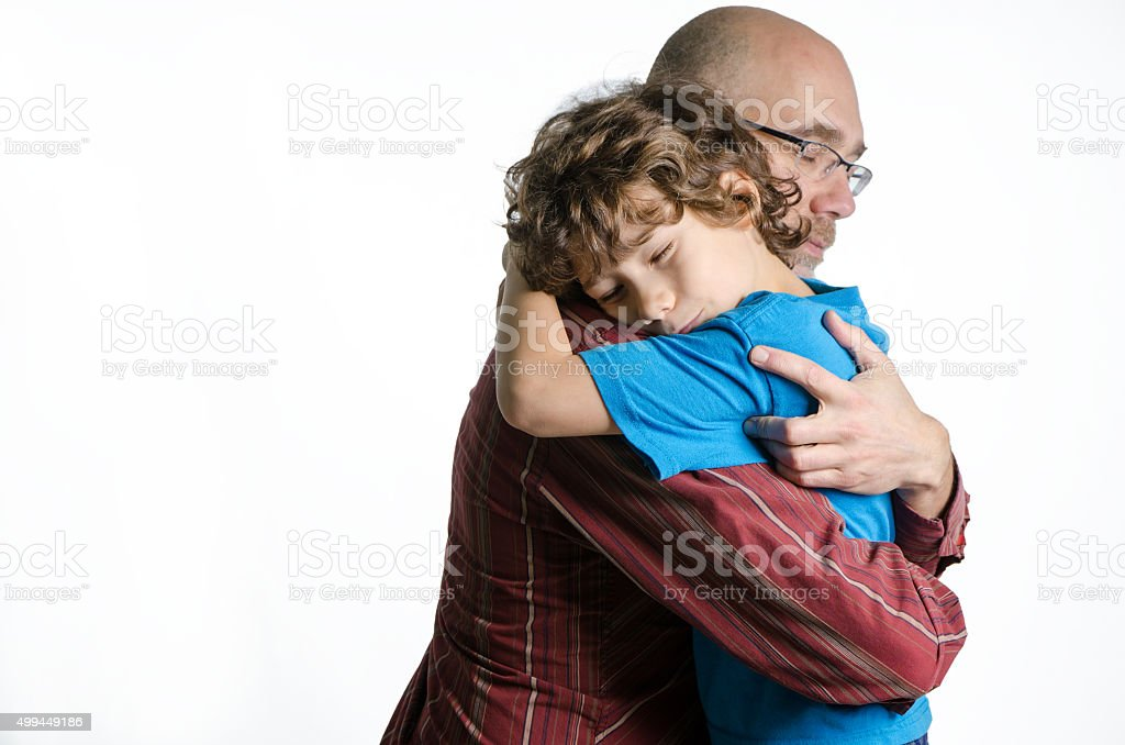 Son and father hug on white background studio stock photo